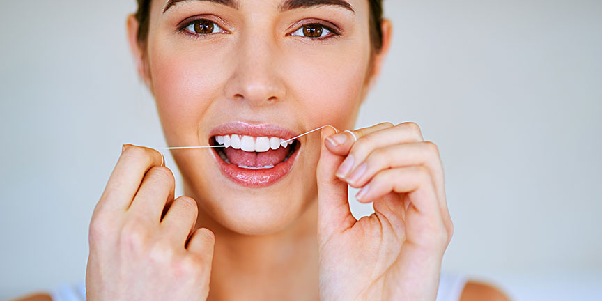 Flossing daily improves dental hygiene
